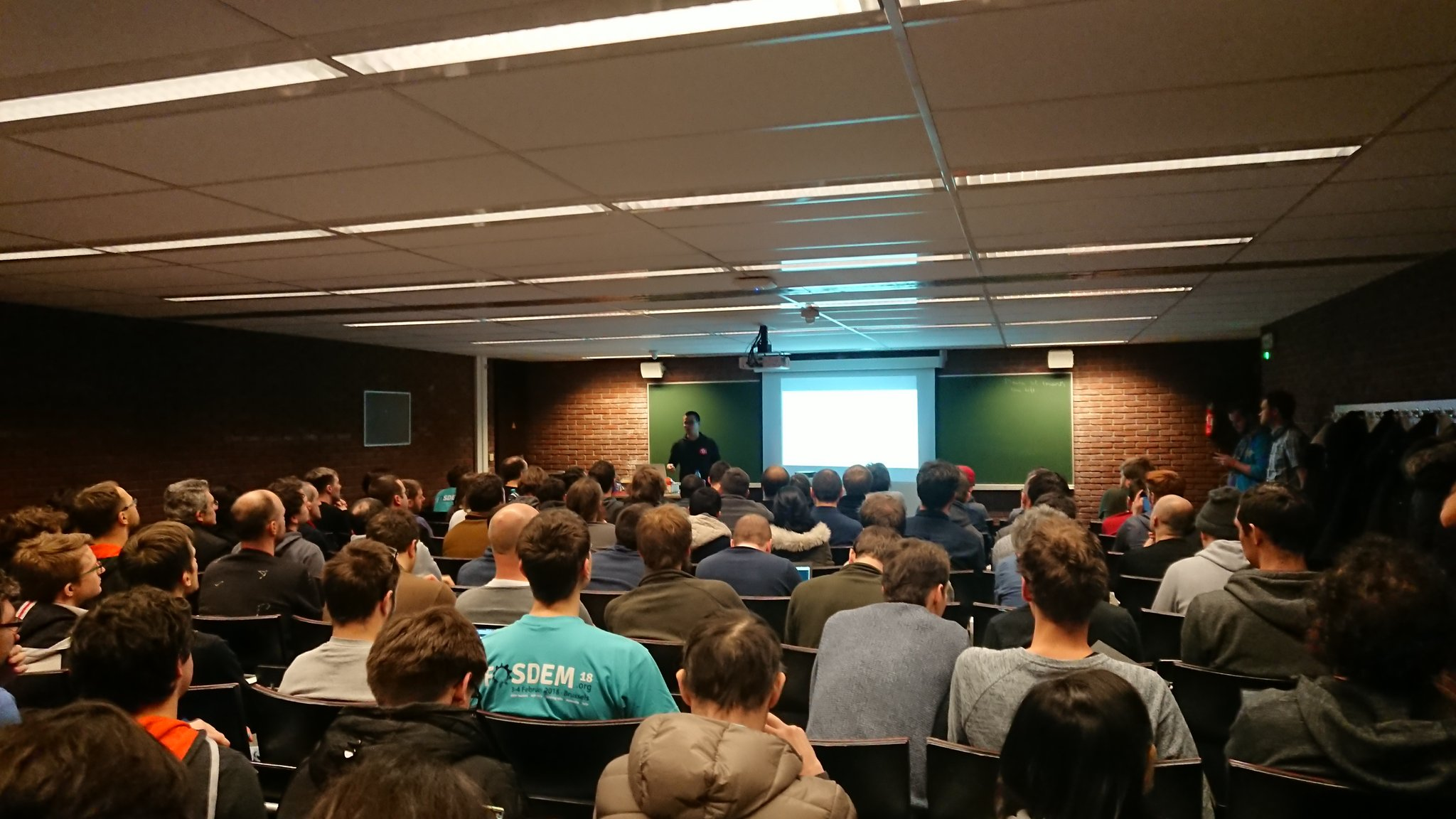 Presenting in front of a group of Rustaceans at FOSDEM 2018